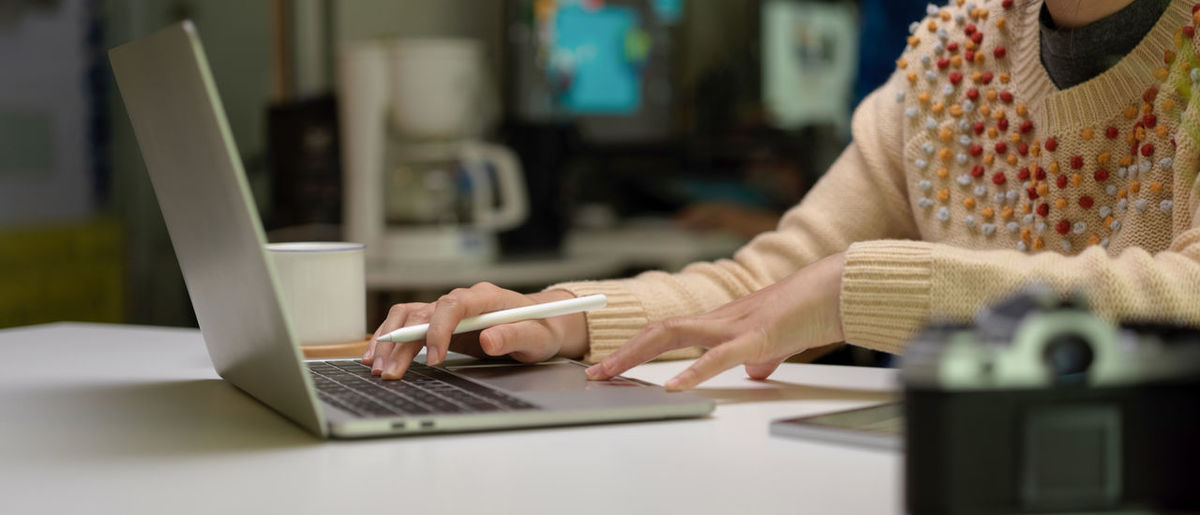 Midsection of woman working at desk
