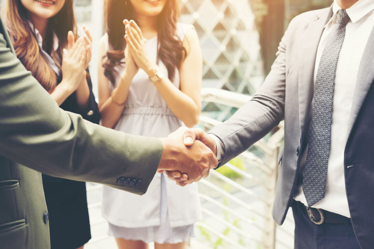 Adult Business Businesswoman Casual Clothing Connection Cooperation Coworker Friendship Group Of People Hand Handshake Human Body Part Human Hand Indoors  Men Midsection Partnership - Teamwork People Positive Emotion Real People Teamwork Togetherness Women