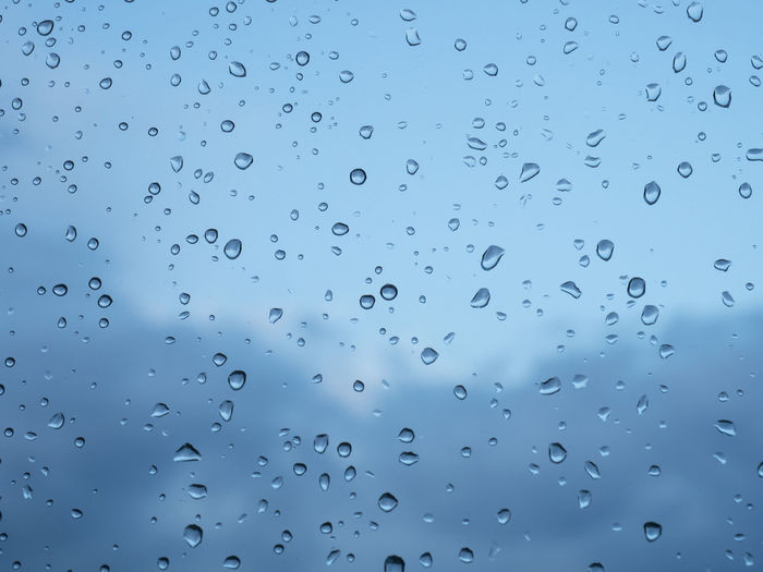 Drop Water Wet Rain Full Frame No People Backgrounds Window Sky Transparent Glass - Material Nature Close-up RainDrop Indoors  Day Pattern Rainy Season Glass Purity