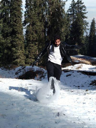 Man kicking snow