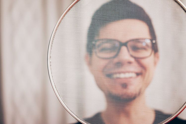 Portrait Of Smiling Man Seen Through Net