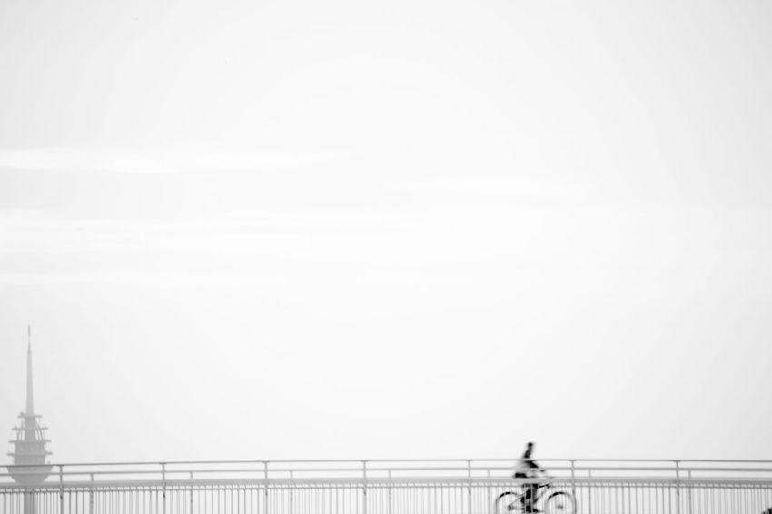 The gray day Bycicle Rider Gray Sky Minimalism Black And White EyeEm Selects Railing Bridge - Man Made Structure Copy Space Sky Footbridge Creative Space #urbanana: The Urban Playground
