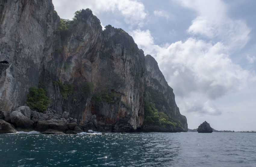 Water Rock Sea Scenics - Nature Beauty In Nature Sky Cliff Rock - Object Tranquil Scene Nature Tranquility Solid Day Mountain Rock Formation No People Waterfront Cloud - Sky Non-urban Scene Outdoors Formation View Into Land Eroded Thailand