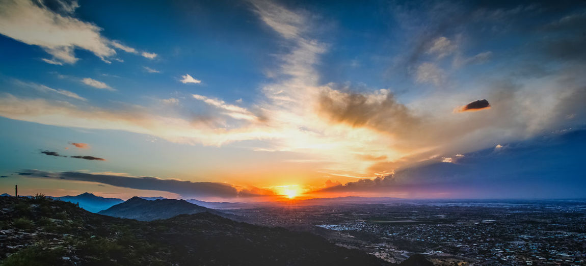 Sunset in Phoenix Atmosphere Beauty In Nature Cloud Cloud - Sky Dramatic Sky Environment Geology Idyllic Landscape Majestic Mountain Mountain Range Nature Non-urban Scene Physical Geography Scenics Sky Sun Sunbeam Sunset Tourism Tranquil Scene Tranquility Travel Destinations Vacations