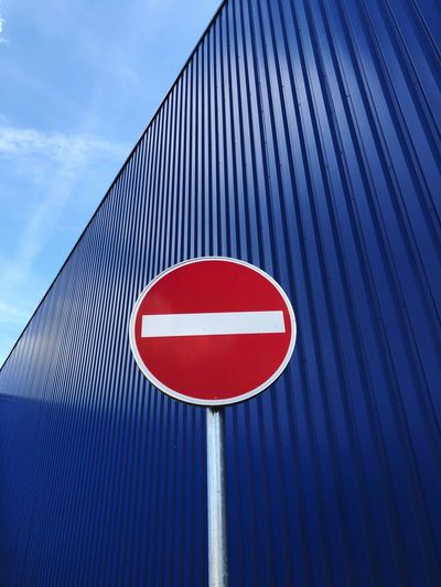 Low Angle View Of Do Not Enter Sign Against Cargo Container