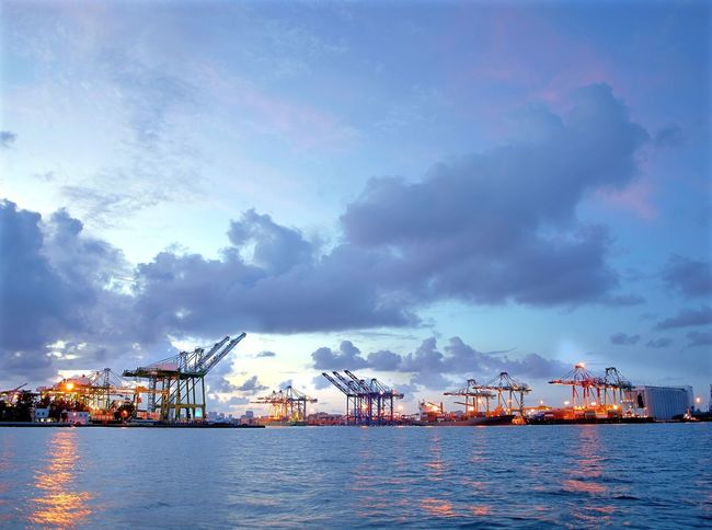 Beautiful view of the container port of Kaohsiung at dusk Blue Hour Cloudscape Commercial Dock Container Crane Container Port Cranes Harbor Industrial Harbour Kaohsiung Reflections In The Water Sky Taiwan Waterfront