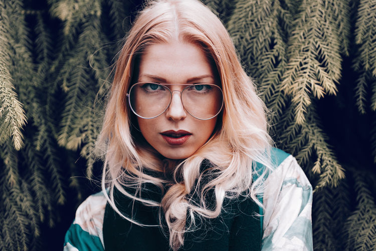 Young women wearing vintage glasses Adult Cool EyeEm Best Shots EyeEm Gallery Fashion Glasses Leipzig Lifestyle Looking At Camera Millenials Portrait Of A Woman Retro Tree Background Blond Hair Face Germany Long Hair Model Vintage Women Women Around The World Young Adult Fashion Stories