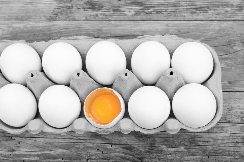 Eggs on table Animal Egg Black And White Chicken Eggs Colorful Egg Food Food And Drink Four Objects Freshness Large Group Of Objects Medium Group Of Objects No People Photoshop Variation