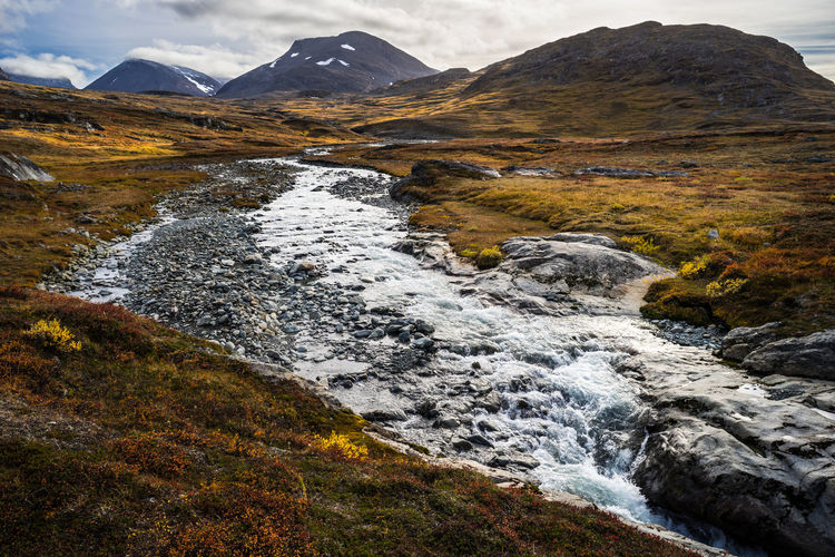 September hiking along The King's Trail in northern Sweden Alesvagge Autumn Brown Day Fall Flowing Flowing Water Hanging Out Kungsleden Motion Mountain Nature No People Northern Europe Outdoors Remote River Scandinavia Stream Sweden The Kings Trail Tranquil Scene Tranquility Valley Water