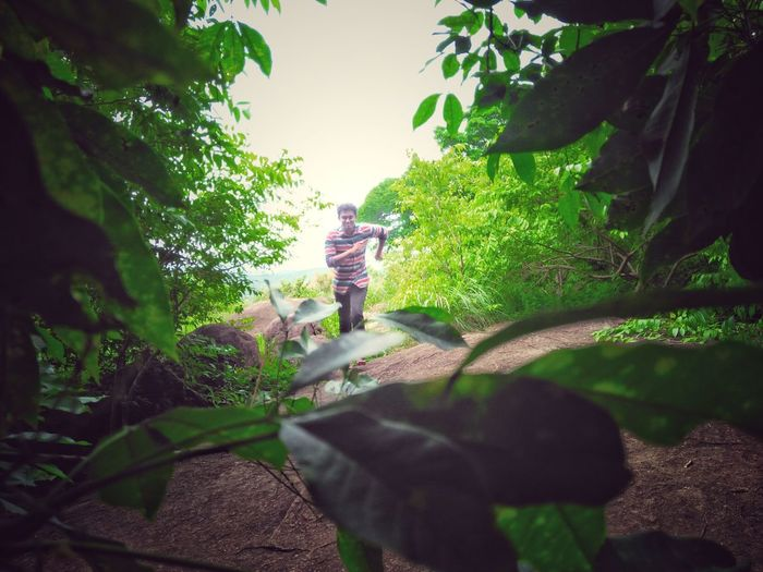 Run through the greenery Nature Outdoors Young Adult Freshness Tree Leaves Freshair Kerala, India Kerala The Gods Own Country ;) Malameltemple Malamel Valakom Kottarakara HillTopView Hill Temple Lost In The Landscape