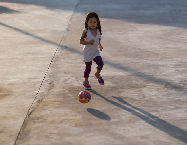 Activity Ball Casual Clothing Child Childhood Children Only City Life Concrete Floor Day Full Length Girl Happiness Leisure Activity Leisure Games One Boy Only One Person Outdoor Pursuit Outdoors People Playing Soccer Speed Out Of The Box