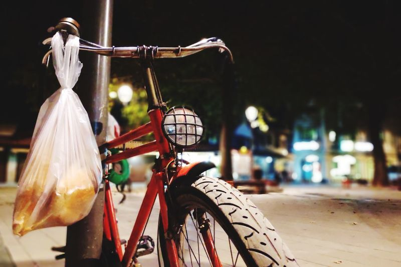 Close-Up Of Plastic Bag Hanging On Bicycle At Night