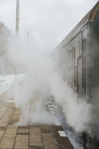 Train on railroad track in fog