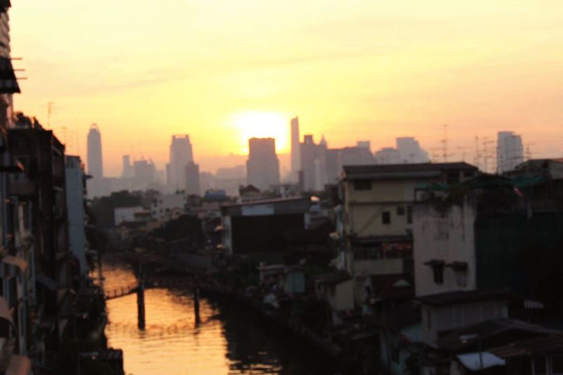 Sun rise in the city. Sunset Sunrise Cityscape Sky Outdoors Building Exterior No People City Built Structure Day Skyscraper Nature Sun River Bangkok