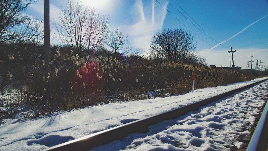 Sun rays This Week On Eyeem Railway Desolate Train Tracks Snow ❄ Light EyeEm Best Shots Showcase: February Nature Cold Temperature Sun Light Sunrays