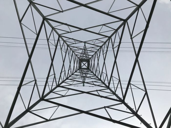 Metal Sky No People Low Angle View Pattern Built Structure Connection Electricity Pylon Architecture Day Power Supply Symmetry Nature Electricity  Cable Complexity Silhouette Outdoors Power Line  Design