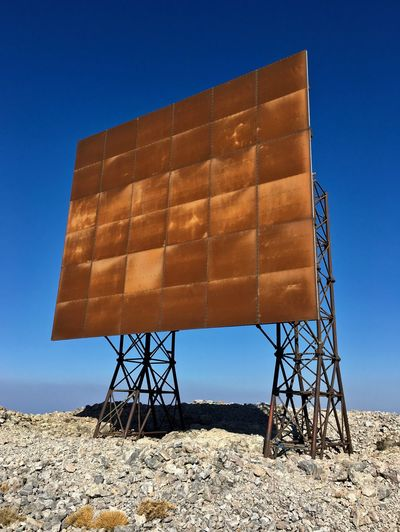 EyeEmNewHere Panel Rust Transmission Architecture Blue Built Structure Clear Sky Day Industry No People Outdoors Reflector Rotten Sky