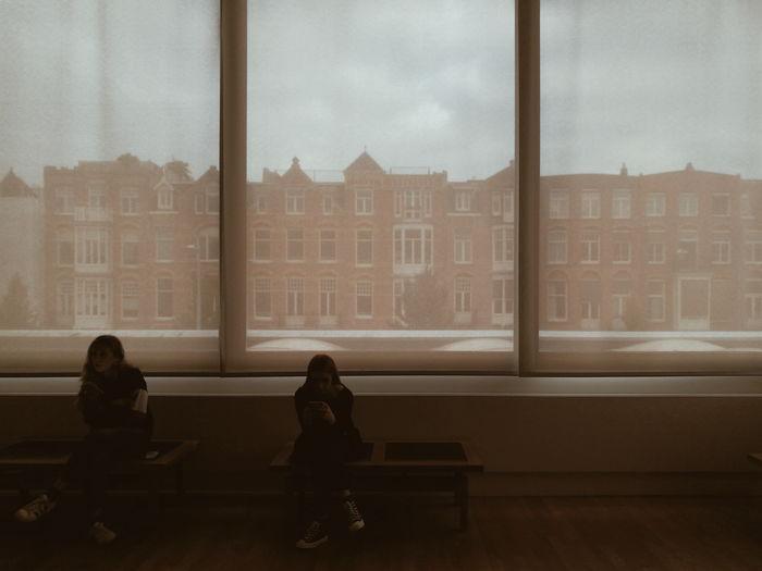People sitting in glass window