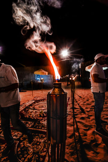 desert safari camp Leading Lines Lighting Equipment Adult Burning Desert Camping Desert Safari Night Camp Flame Full Length Heat - Temperature Illuminated Lifestyles Men Night Outdoors People Real People Rear View Smoke - Physical Structure Smoke Trails Black Backround Standing