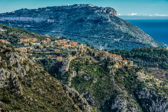 Architecture Beauty In Nature Blue Day Eze Village, France French Riviera La Turbie Landscape Mediterranean Sea Mountain Mountain Peak Mountain Range Nature No People Outdoors Scenics Sea Sky Tourism Tree Vacations Water