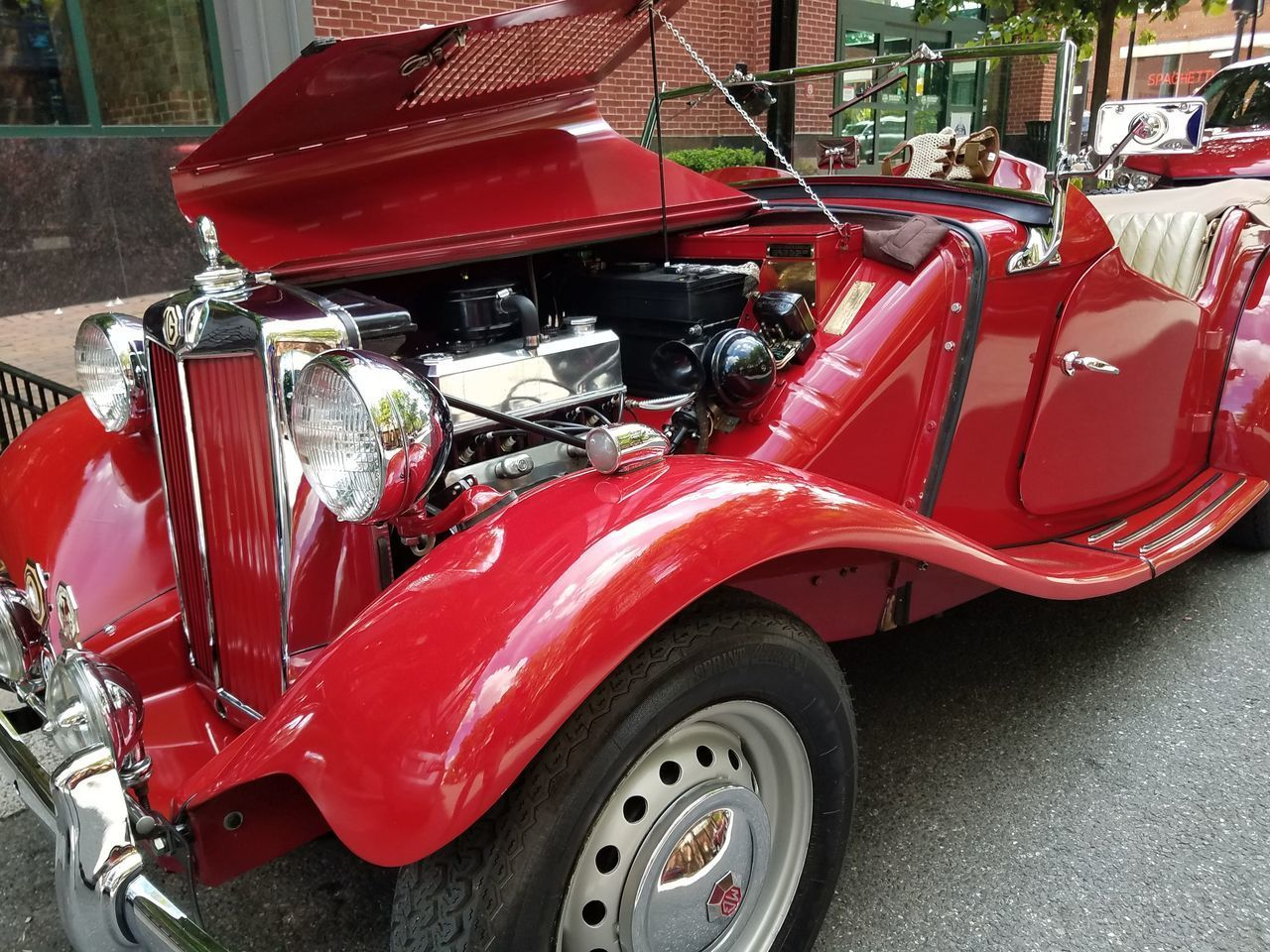 RED VINTAGE CAR ON STREET