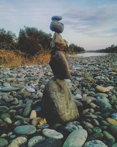 My gf is really good at these! 😊 Outdoors Water Sky Nature Rocks Rockstack Norcal Tranquility Sacramento River Go Outside Red Bluff, California Eye4photography  Northern California EyeEm Gallery Mobile Photography River Clouds Landscape Cloud - Sky Balance Pebble Eye4photography  Stones