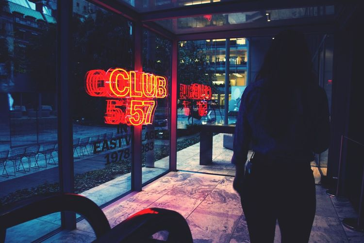 EyeEmNewHere City Indoors  Lifestyles Women Rear View Transportation One Person Communication Real People Text Neon Neon Sign Nightlife Nightlife In The City Club Moma Museum Of Modern Art EyeEm Ready