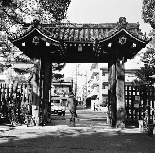 Analogue Photography Black & White Film Japan Japan Photography Japanese Culture Analog Architecture Bike Blackandwhite Blackandwhite Photography Building Exterior Built Structure City Day Film Photography Filmcamera Filmisnotdead Hasselblad Lifestyles Outdoors Real People Riding Street Photography Streetphotography