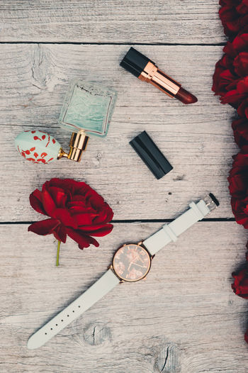 Fashion Accessories Arrangement Blackandwhite Close-up Communication Creativity Directly Above Flower Gray Background High Angle View Indoors  No People Parfum Pastel Personal Accessory Red Ribbon - Sewing Item Roses Rouge Still Life Style Table Watch Wood - Material The Still Life Photographer - 2018 EyeEm Awards The Creative - 2018 EyeEm Awards