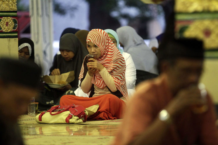 Ramadan in Indonesia. Group Of People Selective Focus Real People Art And Craft Indoors  Representation Clothing Sitting Human Representation Men Group People Retail  Creativity Religion Women Spirituality Lifestyles Store