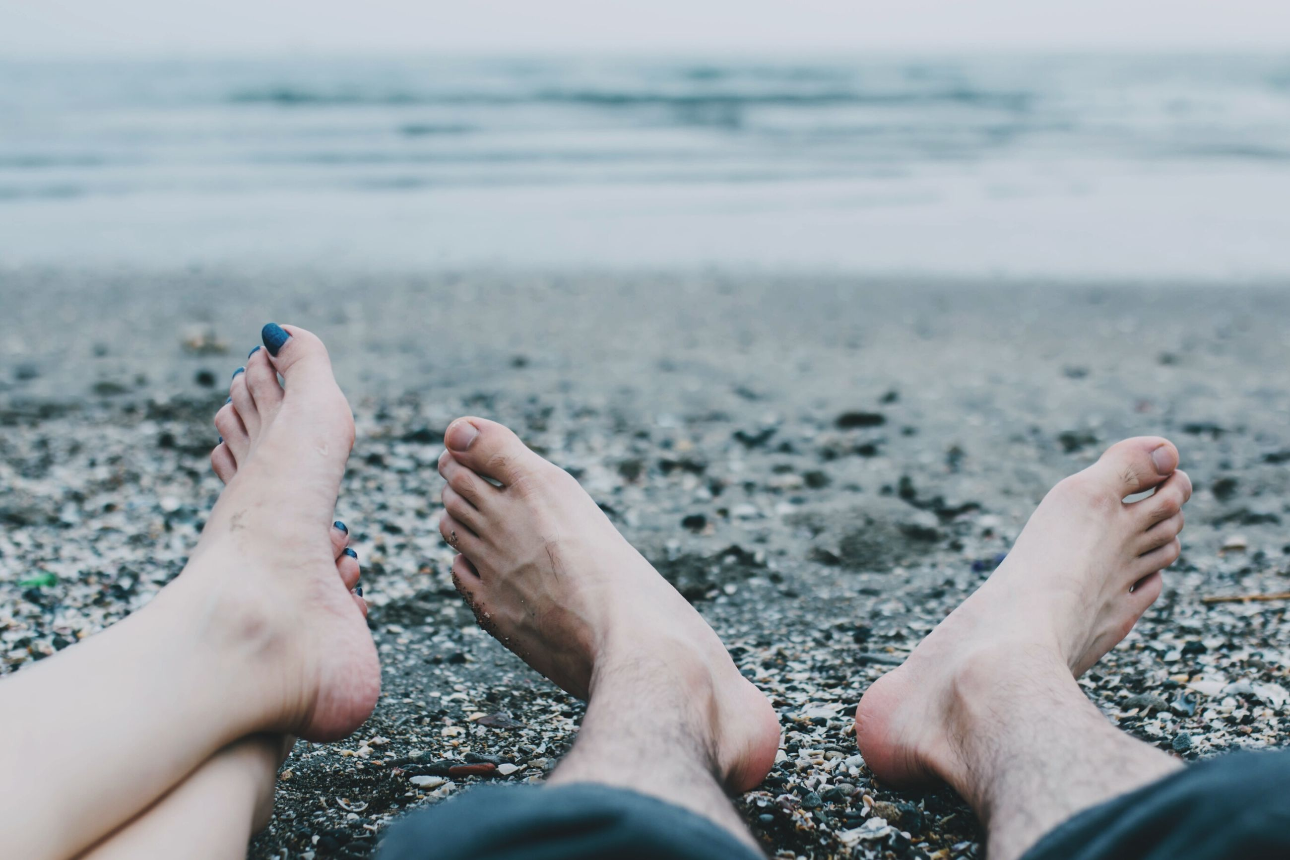 beach, sand, nail polish, barefoot, lifestyles, sea, low section, outdoors, women, real people, day, leisure activity, water, human body part, one person, close-up, people, toenail, adult, nature, pink nail polish, adults only