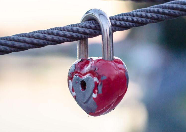Close-up of padlock hanging on rope