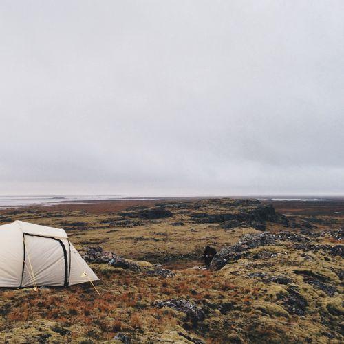 Tent on landscape against sky