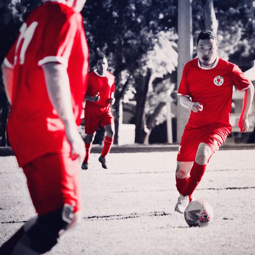 Soccer is life Blackandwhite Men Photography Selective Color Photooftheday EyeEm Gallery EyeEm Picoftheday Soccer Red Sport Group Of People Clothing Motion People Men Competition Playing Day Full Length Adult Cold Temperature Winter Togetherness Outdoors Group Team Sport Nature Real People
