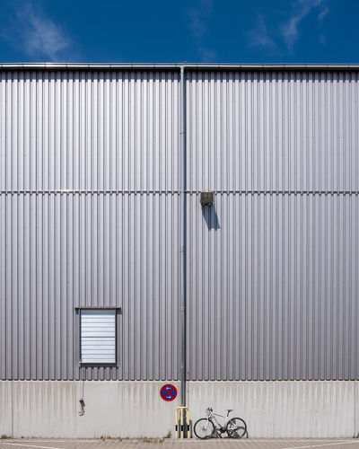 Architecture Metal Built Structure Building Exterior Day Building Corrugated Iron Iron No People Cloud - Sky Corrugated Pattern Sky Industry Blue Outdoors Nature Closed City Gate Garage