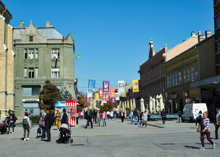 European Cities Novi Sad Serbia Balkans Europe Eastern Europe Outdoors Travel Destinations Architecture Clear Blue Sky Building Exterior Built Structure City Day Pedestrian Walkway Real People Cityscape City Life City Street Lifestyles Women Men Group Of People Building Flags Sunlight Leisure Activity