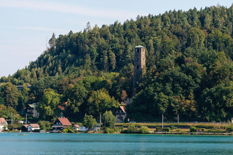 WORTHERSEE, AUSTRIA - AUGUST 08, 2018: Great scenery from the boat to the shore line of the lake, beautiful buildings, mountains, forests, highways. Tourists who enjoy a variety of water recreation types. Nature Day Outdoors Austria Carinthia Carinthian Lakes Tourist Tourists Lake Wörthersee Recreation  Leisure Landscape Water Sea Boats Motorboat Speedboats Summer People Holidays Fun Travel Beach Resort Lifestyle Sunny Rest Joy Waves Europe Alps Alpine Alpine Lake Tree Plant Waterfront Architecture Built Structure Growth Mountain River Transportation Forest Scenics - Nature Sky Beauty In Nature Building Exterior No People