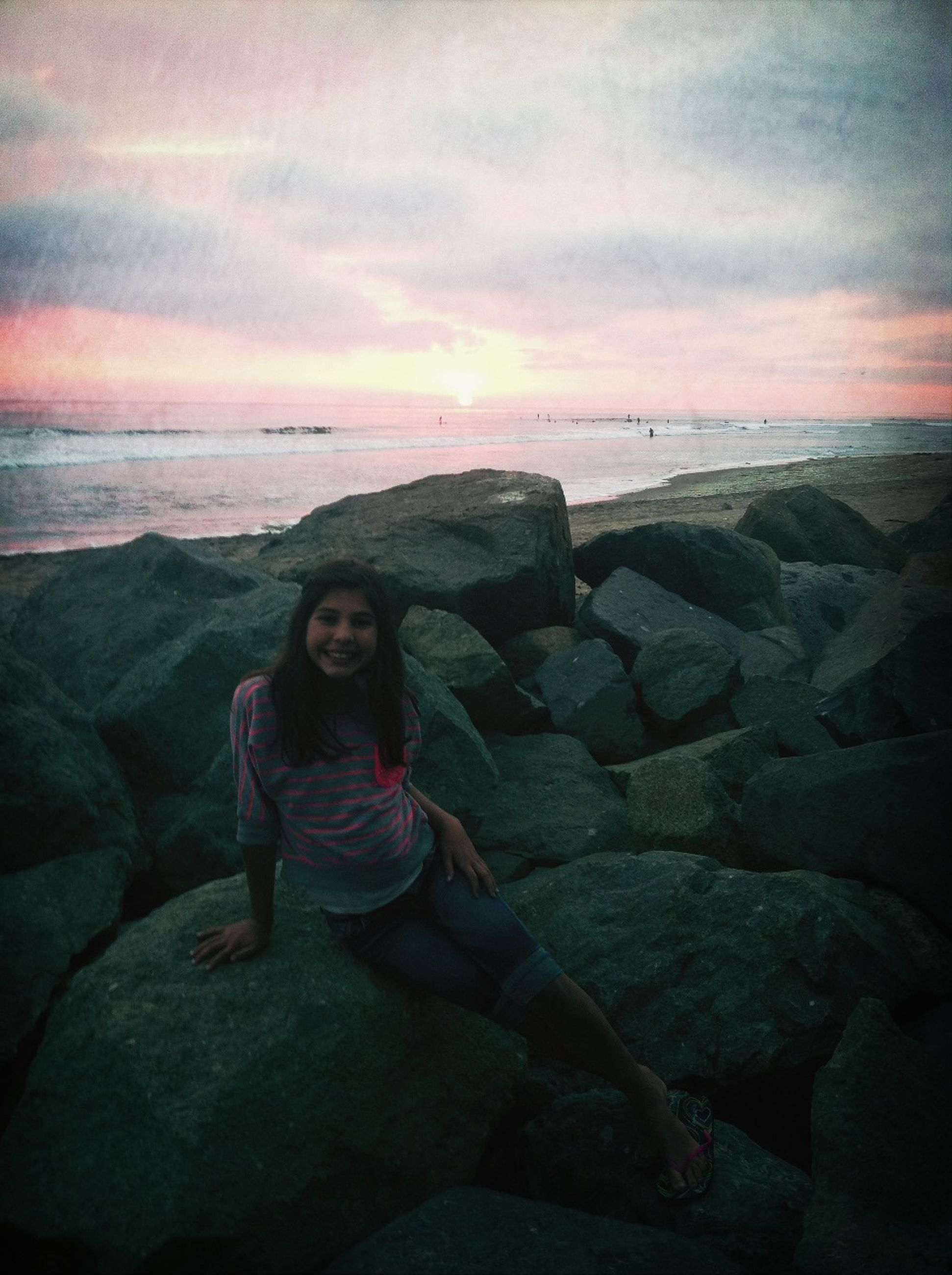 lifestyles, sky, leisure activity, sea, sunset, horizon over water, cloud - sky, water, standing, casual clothing, beach, full length, scenics, young women, young adult, person, beauty in nature, tranquil scene