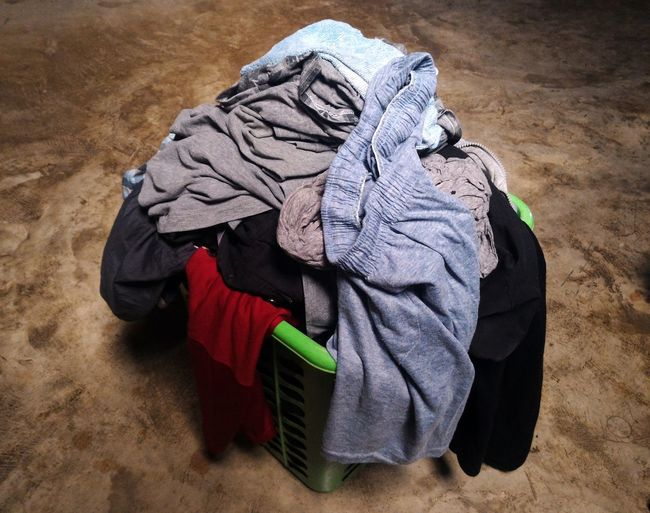 Pile Of Clothes In Basket On Floor