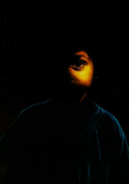 Light from darkness. Child Childhood Boy Portrait Portrait Photography Portraits Portraiture Portraits Of EyeEm EyeEm Best Shots EyeEmBestPics EyeEm Best Edits EyeEm Gallery Mobilephotography Black Background Dark Portrait Young Adult One Person Headshot Adult Body Part Studio Shot Human Body Part Front View Mystery Human Face Indoors  Close-up Beauty Copy Space