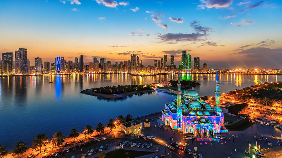 A shot taken in Sharjah-UAE during the Sharjah Light Festival Sharjah Architecture Building Exterior City Cityscape Illuminated Night No People Outdoors Sky Skyscraper Sunset Travel Destinations Water California Dreamin #urbanana: The Urban Playground