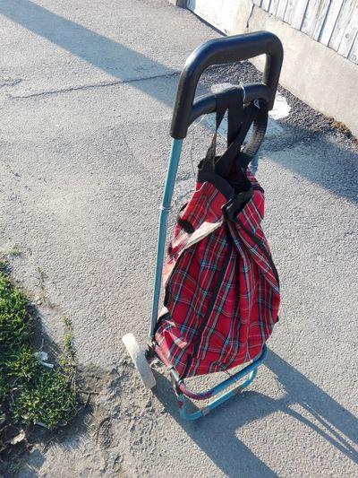 Hand Cart Hand Trolley Bag On Wheels Trolley Cart Shadow Red Sunlight Road High Angle View Street Asphalt Sidewalk
