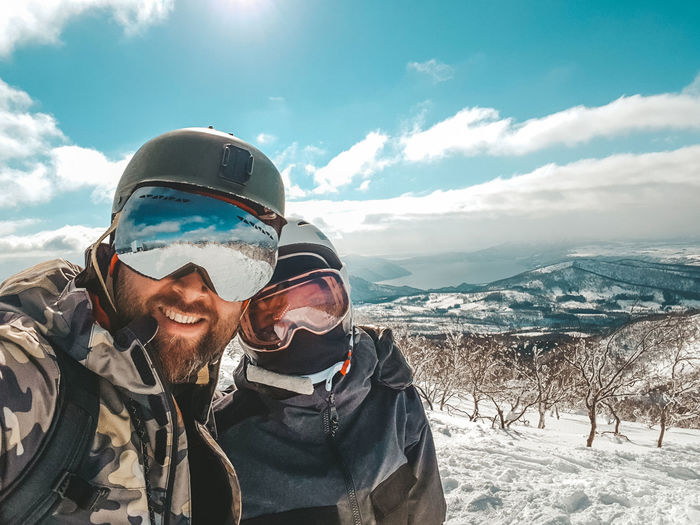 Cold Weather Winter Smiling Snow Portrait Cold Temperature Happiness Cloud - Sky Leisure Activity Looking At Camera Clothing Adult Lifestyles Men Mountain Range Real People Vacations Sky Nature Warm Clothing Adventurous Active Lifestyle  Couple - Relationship Adventure Selfie
