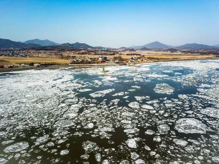 Drift ice of Choji Bridge in Kanghwa island, Korea. WinterSea Winter Ganghwa Island Drone Shot Drone Photography Korea Winter Lighthouse High Angle View Mountain Sky Water Scenics - Nature Nature Day Architecture Beauty In Nature No People Tranquility Tranquil Scene Clear Sky Outdoors