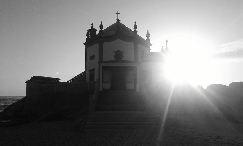 Lens Flare Sunlight Architecture History No People Travel Destinations Sunset Built Structure Outdoors Day Sky Sea Beach Photography Church Architecture Chapel On The Beach EyeEmNewHere