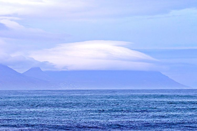 Water Sea Scenics - Nature Beauty In Nature Tranquil Scene Tranquility Sky Cloud - Sky Mountain Non-urban Scene Waterfront Horizon Horizon Over Water Nature Outdoors No People Table Mountain Under Cover