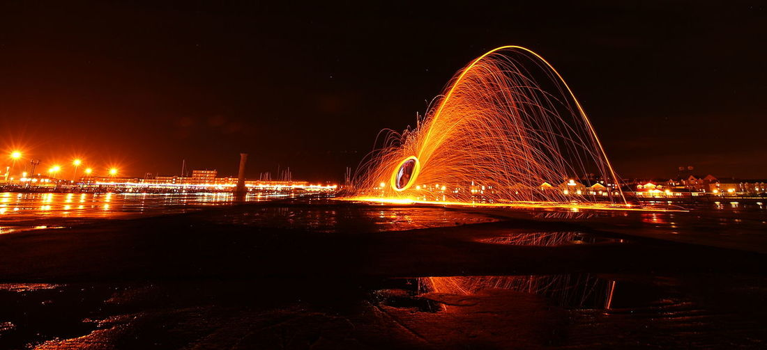 Wire Wool spinning Motion Illuminated Long Exposure Night Wire Wool Nature Outdoors Water Architecture Built Structure Building Exterior Reflection Sky City No People Travel Destinations Bridge River Bridge - Man Made Structure Connection