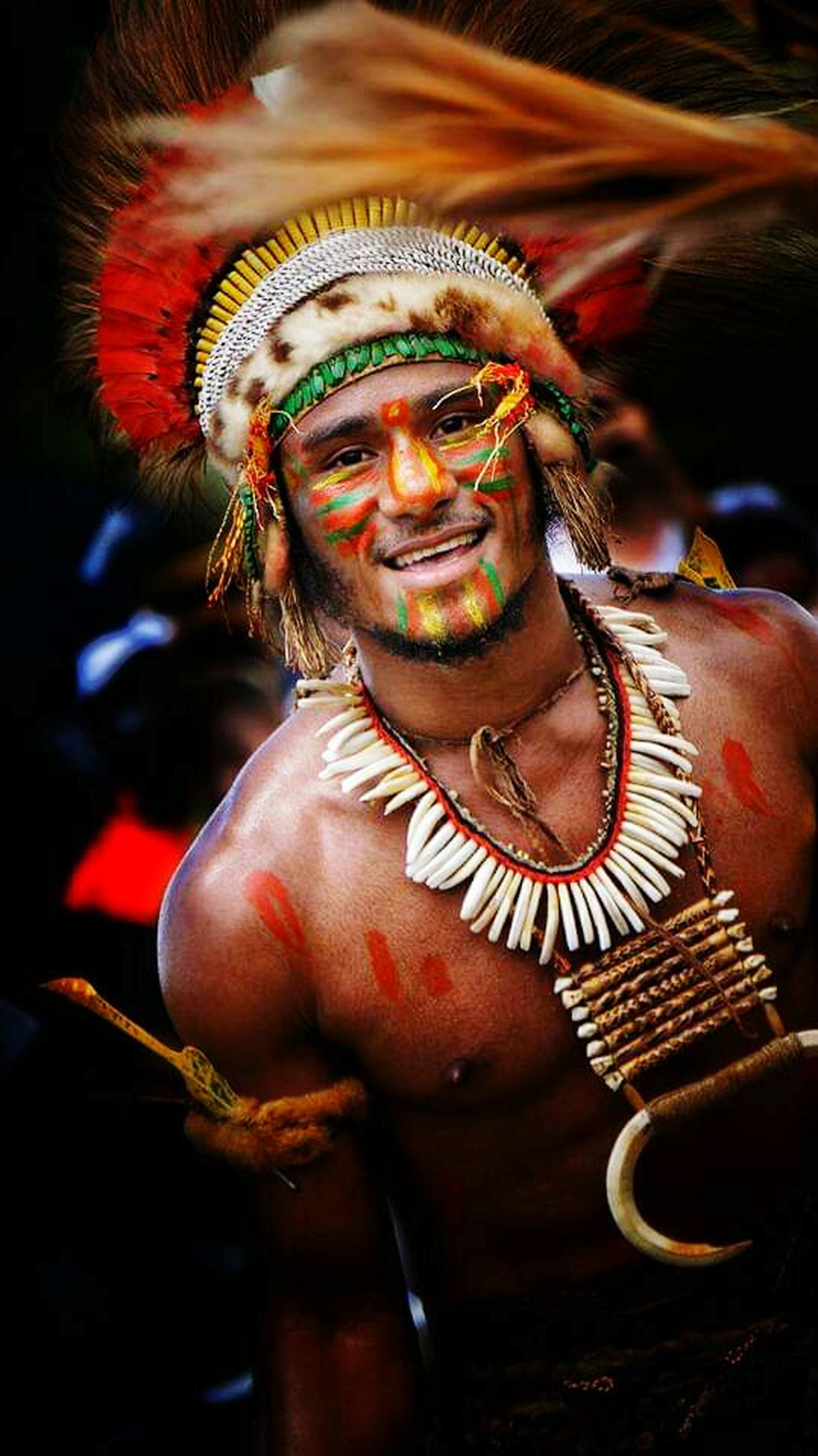 one person, adult, celebration, men, smiling, traditional clothing, clothing, event, face paint, males, portrait, dancing, headwear, performance, mature adult, emotion, happiness, headdress, mature men