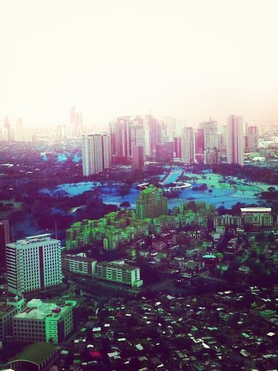 View of the Metro as the airplane lands Skyline Metro Manila Home Sweet Home Foggy Afternoon