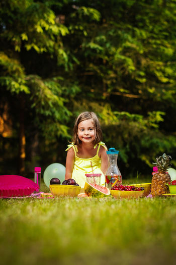 Picnic Girl Child Childhood Kid Forest Summer Grass Girls Women Females Portrait Plant Front Or Back Yard Nature Day Front View Sitting Full Length People Food Looking At Camera Lifestyles Innocence Outdoors Easter Egg Hunt
